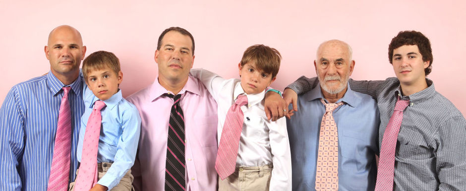 Group of Men and Boys wearing pink ties